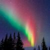 The Aurora Borealis blazes across the sky above Churchill, Manitoba.