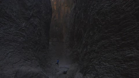 Standing in a mountain crevice